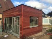 Een aanbouw in houtskeletbouw in Gistel